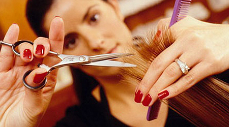Image of a woman cutting hair at a salon