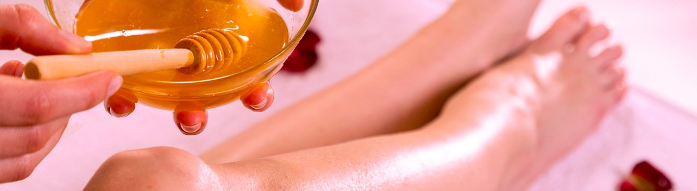 Image of woman getting waxing treatment